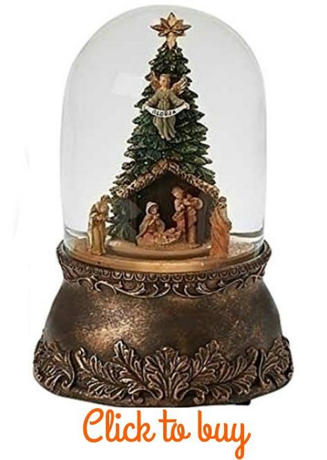 Snow globe nativity scene with tree.