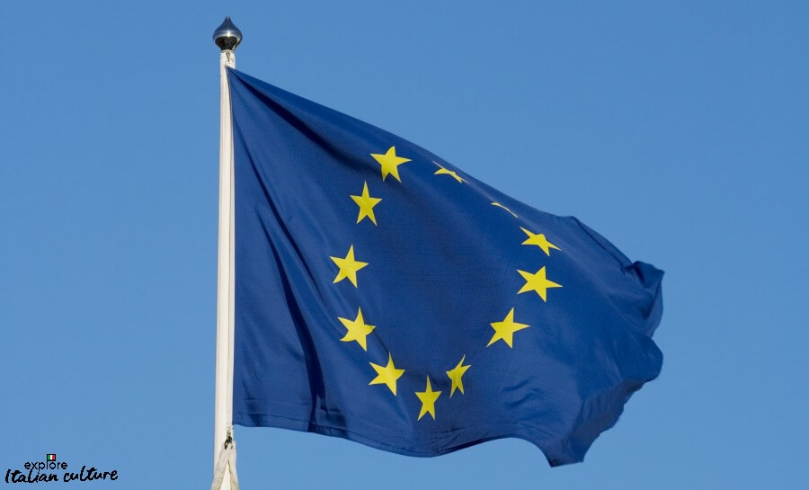 12 gold stars on a blue background: The flag of the European Union.