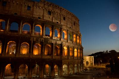Ancient Roman Colosseum in moonlight