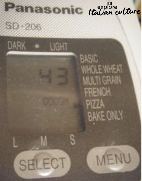 The timer on the Panasonic bread maker, set to pizza dough mode.