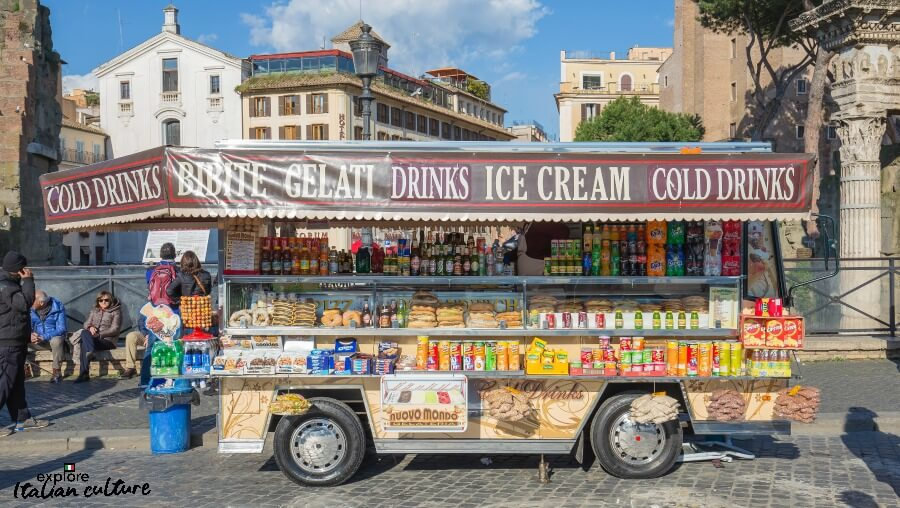 Buying cold drinks in Rome at a vendor stall.