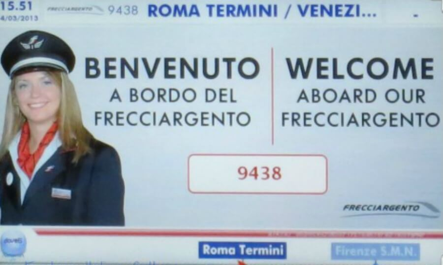 Welcome sign on an Italian train from Rome to Venice.