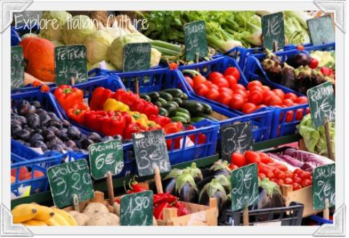 Italian market stall selling Mediterranean vegetables