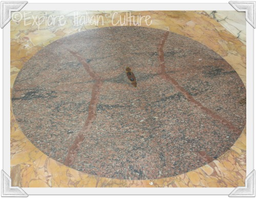 Beautiful red marble floor of the Pantheon with drainage hole for rain