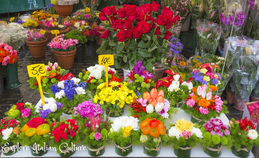 Buckets of flowers in the Campo de'Fiori market, Rome, Italy.