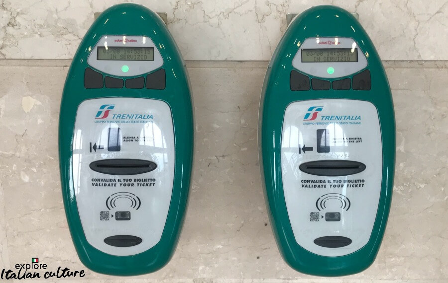 Ticket validation machines at an Italian train station.