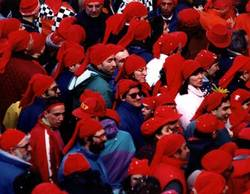 Traditions of Mardi Gras in Ivrea - red hats